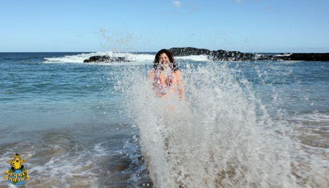 Sue taken unaware by a wave on the island of Kauai, Hawaii