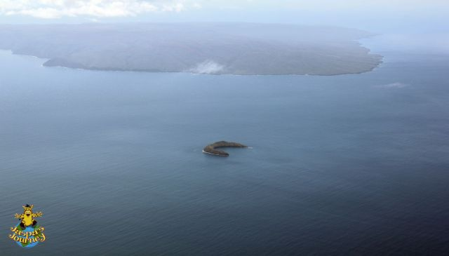 Molokini Crater from the air, with Kahoolawe in the distance